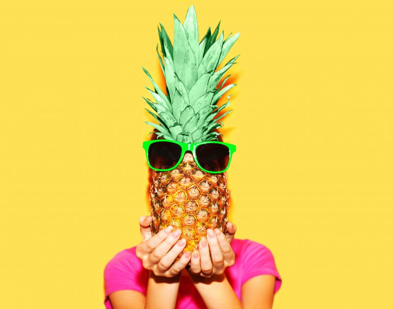 Fashion portrait woman and pineapple with sunglasses over colorf