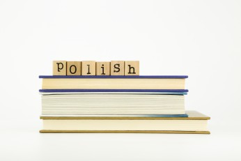 polish language word on wood stamps and books